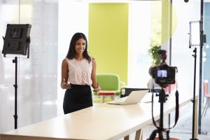 young woman making a corporate demonstration video PLW7P8M