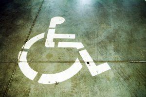 disability sign on grunge garage floor PE7WZCB